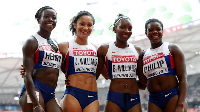 Britain poses after their women's 4 x 100 metres relay heat at the 15th IAAF Championships at the National Stadium in Beijing