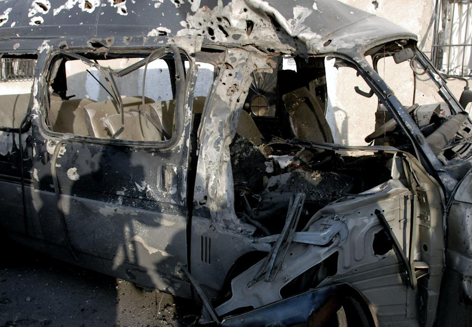 This photo released by the Syrian official news agency SANA, shows a damaged vehicle at the scene after an attack in Damascus, Syria, Wednesday, Nov. 7, 2012. (AP Photo/SANA)