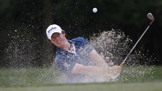 Rory McIlroy, of Northern Ireland, chips out of a bunker to the 14th green during the first round of the U.S. Open Championship golf tournament in Bethesda, Md., Thursday, June 16, 2011. (AP Photo/Matt Slocum)