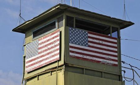 A U.S. Marine guard tower overlooks the Northeast gate leading into Cuba territory at Guantanamo Bay U.S. Naval Base