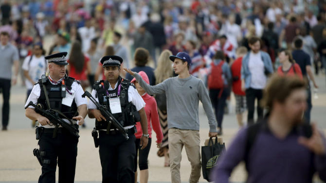 Police patrol in Olympic Park during the 2012 Summer Olympics Saturday, Aug. 11, 2012, in London. (AP Photo/Charlie Riedel)