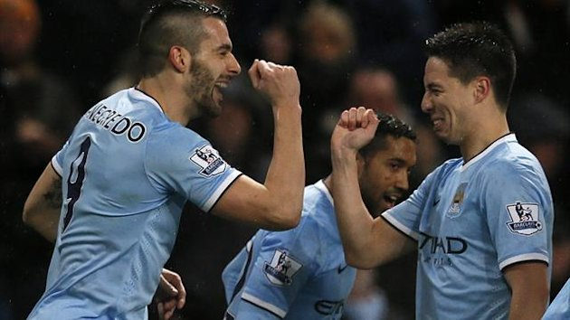 Manchester City's Alvaro Negredo (L) celebrates scoring with Samir Nasri against West Ham United (Reuters)