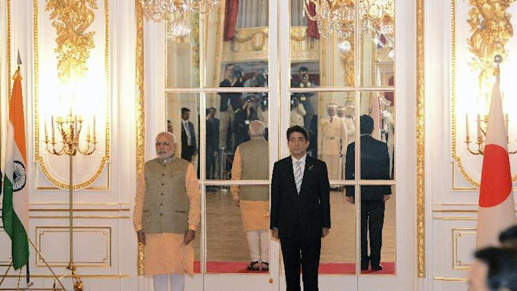 Indian Prime Minister Narendra Modi, left, and Japanese Prime Minister Shinzo Abe listen to national anthems during a welcome ceremony at Akasaka State Guesthouse in Tokyo Monday, Sept. 1, 2014. Modi was on a his official visit to Japan. (AP Photo/Ma Ping, Pool)