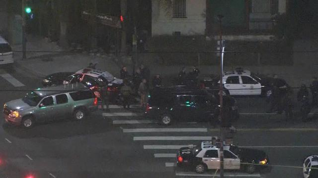 Amid tensions with police forces, shots fired at cops in L.A., Florida