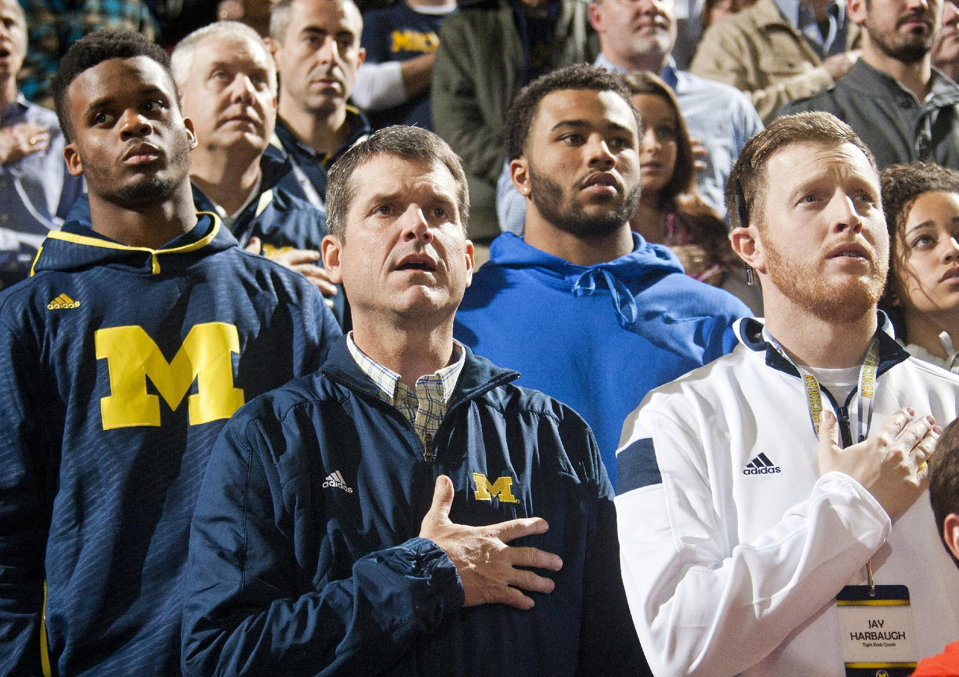 Woman assisted by Jim Harbaugh in crash didn't know him