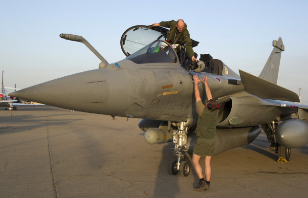 This Sunday Jan.13, 2013 photo provided by the French Army Monday Jan.14, 2013 shows a pilot exiting a jetfighter after a mission to Mali in N'Djamena, Chad. French fighter jets bombed rebel targets i
