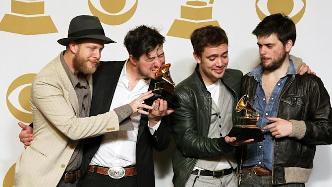 "Members of the musical group Mumford & Sons, from left, Ted Dwane, Marcus Mumford, Ben Lovett and Winston Marshall, pose backstage with the best long form music video award for ""Big Easy Express"" and the album of the year award for ""Babel"" at the 55th annual Grammy Awards on Sunday, Feb. 10, 2013, in Los Angeles. (Photo by Matt Sayles/Invision/AP)"