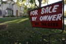 This Wednesday, Oct. 10, 2012 photo shows a for-sale sign at a home in Glenview, Ill. Average U.S. mortgage rates rose slightly this week and continued to hover near record lows. (AP Photo/Nam Y. Huh)