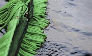 Absorbent foam is used to soak up crude oil in the La Chaudiere River in Lac-Megantic, Quebec