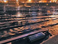 In a photo made available by the Metropolitan Transportation Authority on Tuesday, Oct. 30, 2012 floodwaters stream into the Long Island Rail Road's West Side Yard in New York during superstorm Sandy. All trains had been removed from the yard prior to the arrival of the storm. (AP Photo/Metropolitan Transportation Authority)