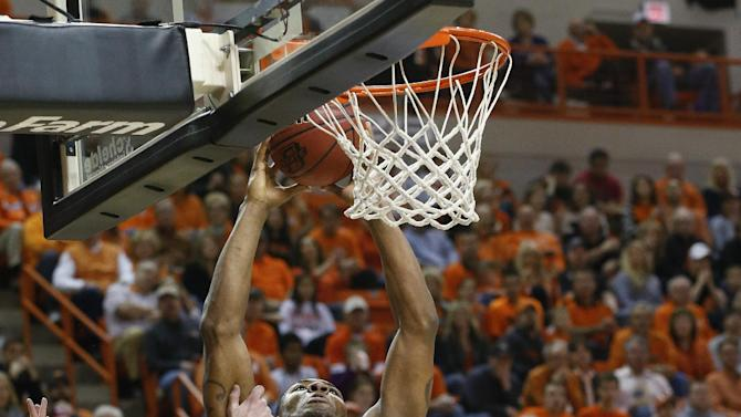 Oklahoma State guard Marcus Smart (33) is fouled by Kansas State guard Will Spradling (55) during the first half of an NCAA college basketball game in Stillwater, Okla., Saturday, March 9, 2013. (AP Photo/Sue Ogrocki)