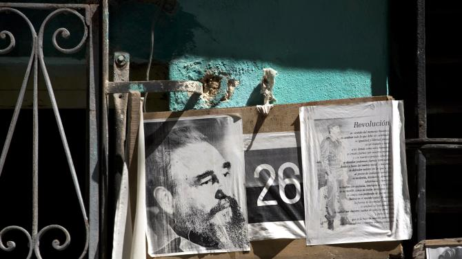 """Images of Cuba's former leader, Fidel Castro, adorn a wall of a home in Havana, Cuba, Wednesday, Aug. 28, 2013. Castro said last year he was ending his second career as a columnist. But the retired leader is apparently so consumed by world affairs that he's making a comeback. In a column published by official media Wednesday, Castro denies a recent report by a Russian newspaper alleging that Cuba refused to let NSA leaker Edward Snowden pass through the island en route to Latin America. Castro calls that a """"paid-for lie."""" He says he admires Snowden's """"bravery."""" (AP Photo/Ramon Espinosa)"""