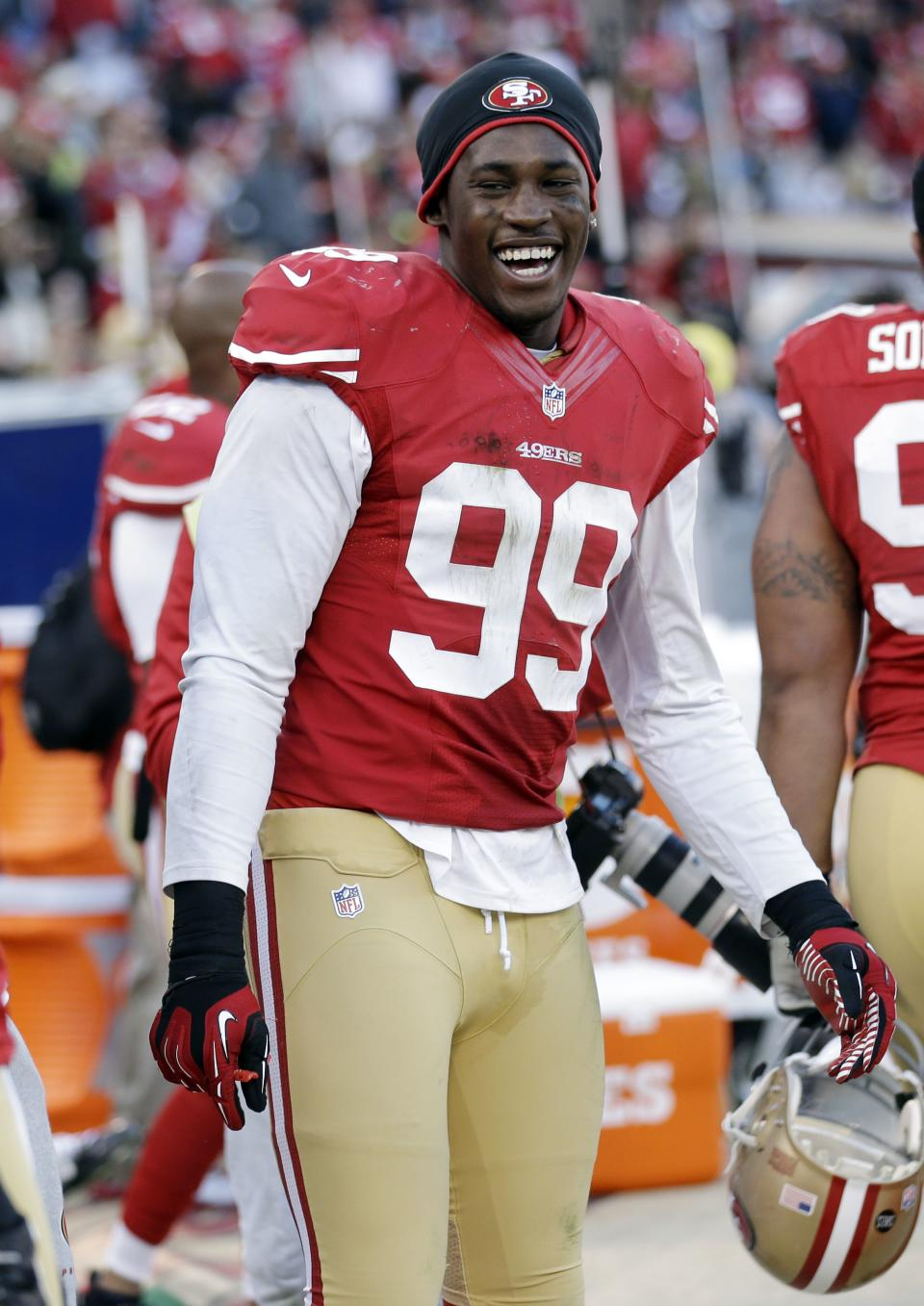 San Francisco 49ers outside linebacker Aldon Smith (99) smiles near the end of an NFL football game against the Arizona Cardinals in San Francisco, Sunday, Dec. 30, 2012. San Francisco won won 27-13. (AP Photo/Marcio Jose Sanchez)