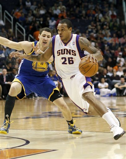 Ellis' jumper lifts Warriors past Suns, 106-104