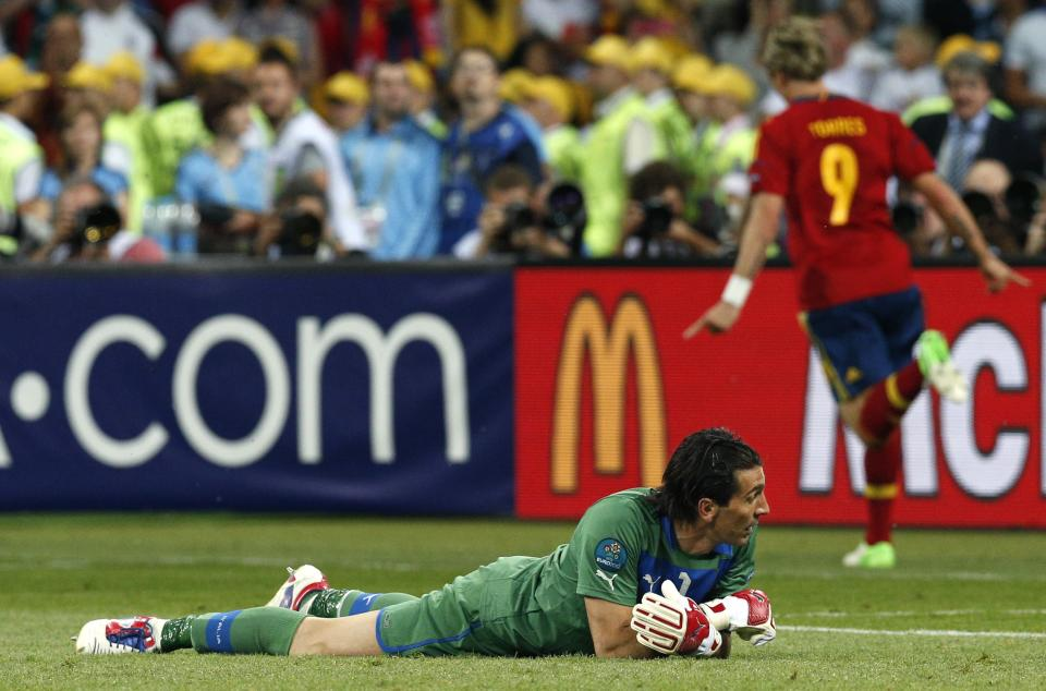 Italy goalkeeper Gianluigi Buffon reacts after Spain's Fernando Torres scored his sides 3rd goal during the Euro 2012 soccer championship final  between Spain and Italy in Kiev, Ukraine, Sunday, July 1, 2012.  (AP Photo/Michael Sohn)