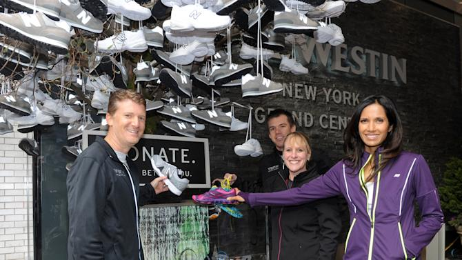 IMAGE DISTRIBUTED FOR WESTIN - Padma Lakshmi, right, joins Brian Povinelli, left, Global Brand Leader, and Bob Jacobs, VP of Brand Management from Westin Hotels & Resorts, and Hilary Keates, Director of Global Marketing & Brand Management, New Balance, Thursday, Nov. 15, 2012 in New York to donate sneakers to benefit Soles4Souls and Hurricane Sandy relief. Thousands of associates around the world ran a 5K in support of the brands' pledge to donate 15,000 pairs of shoes to Soles4Souls in celebration of the global launch of Westin's New Balance gear lending program. (Photo by Diane Bondareff/Invision for Westin/AP Images)