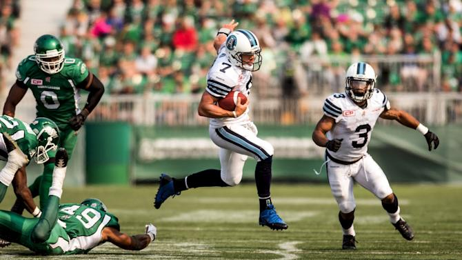 Toronto Argonauts quarterback Trevor Harris evades the Saskatchewan Roughriders defence during overtime play in their CFL football game in Regina, Saskatchewan