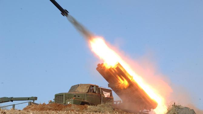 """FILE - In this undated file photo released by the Korean Central News Agency (KCNA) and distributed Thursday, March 14, 2013, by the Korea News Service, a rocket launcher is fired during a live drill by the Jangjae Islet Defense Detachment and the Mu Islet Hero Defense Detachment deployed in the southwestern sector of North Korea. North Korea's military, founded 81 years ago Thursday, April 25, is older than the country itself. It began as an anti-Japanese militia and is now the heart of the nation's """"military first"""" policy. Late leader Kim Jong Il elevated the military's role during his 17-year rule, boosting troop levels to an estimated 1.2 million soldiers, according to the South Korean government. The military's new supreme commander, Kim Jong Un, gave the Korean People's Army a sharpened focus this year by instructing troops to build a """"nuclear arms force."""" (AP Photo/KCNA via KNS, File)"""
