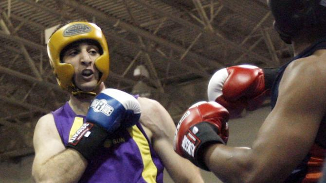 FILE - In this May 4, 2009 file photo,  Tamerlan Tsarnaev, left, fights Lamar Fenner of Chicago, in the 201 weight class, during the 2009 Golden Gloves National Boxing Tournament at the Salt Palace, Monday, May 4,  2009. Tsameav was identified as a suspect in the Boston Marathon bombings.  Tsarnaev, who had been known to the FBI as Suspect No. 1 and was seen in surveillance footage in a black baseball cap, was killed overnight Thursday during a getaway attempt, officials said. On Friday, April 19, 2013, thousands of officers were swarming the streets in and around Boston hunting for Tsarnaev's younger brother, Dzhokhar Tsarnaev, 19. (AP Photo/The Salt Lake Tribune, Rick Egan)  DESERET NEWS OUT; LOCAL TV OUT; MAGS OUT