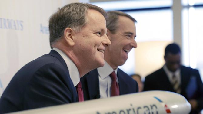 U.S. Airways CEO Doug Parker, left, and American Airlines CEO Tom Horton laugh during a news conference at DFW International Airport Thursday, Feb. 14, 2013, in Grapevine, Texas. The two airlines will merge forming the world's largest airlines.  (AP Photo/LM Otero)