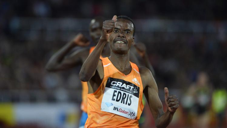 Muktar Edris of Ethiopia gestures after winning the 5000 metres event during the IAAF Diamond League at the Stockholm Olympic Stadium