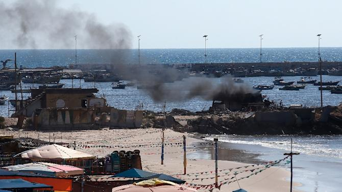 Smoke billows from a beach shack following an Israeli military strike on July 16, 2014 in Gaza City which killed four children