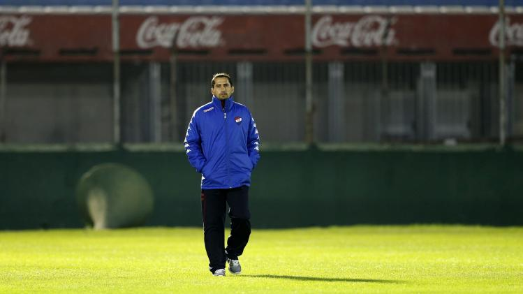 Head coach of Paraguay's Nacional Gustavo Morinigo walks along the field at the Centenario stadium in Montevideo