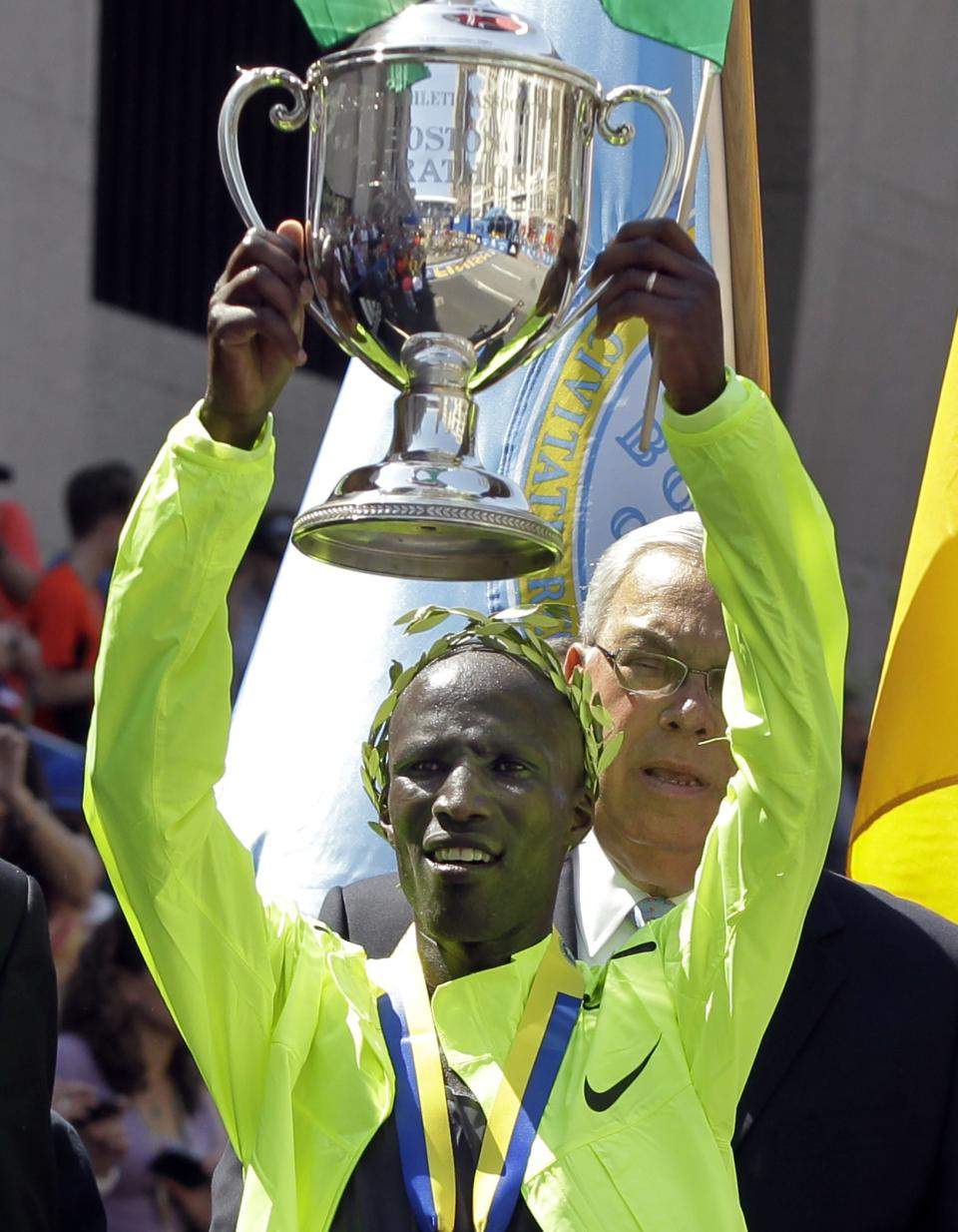 Wesley Korir of Kenya hold his trophy after winning the men's division of the 2012 Boston Marathon in Boston, Monday, April 16, 2012. (AP Photo/Elise Amendola)