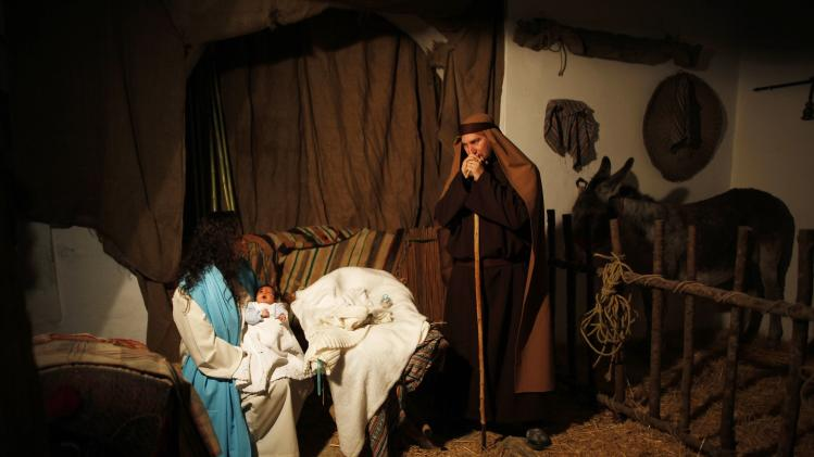 People take part in a re-enactment of the nativity scene, in Arcos de la Frontera