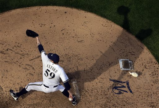 Rodriguez finishes Brewers' 2-0 win for 300th save