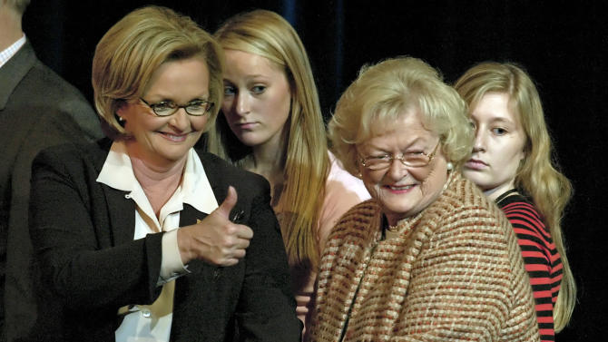"""FILE - In this Oct. 11, 2006 file photo, then-candidate for U.S. Senate Claire McCaskill, left, gives the thumbs up to supporters as she holds the hand of her mother, Betty Anne McCaskill, after her debate against incumbent Sen. Jim Talent at Clayton high school in Clayton, Mo. McCaskill's campaign said that 84-year-old Betty Anne Ward McCaskill died Monday, Oct. 29, 2012 at her home in St. Louis. The Democratic senator had said Saturday that her mother suffered from """"acute cardio-renal failure"""" and had lost consciousness at several points in recent days. (AP Photo/Tom Gannam, File)"""