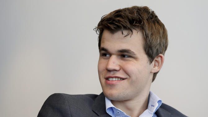 FILE - In this photo taken Monday April 29, 2013 Norwegian chess champion Magnus Carlsen smiles during a press conference in Oslo. Carlsen has brought an injection of cool to the normally sedate world of global chess. And the 22-year-old's home country is buzzing with excitement as he competes in a tournament here months before he tries to crack the greatest prize in the game: the chess World Championship. (AP Photo/Erlend Aas, Scanpix, File) NORWAY OUT