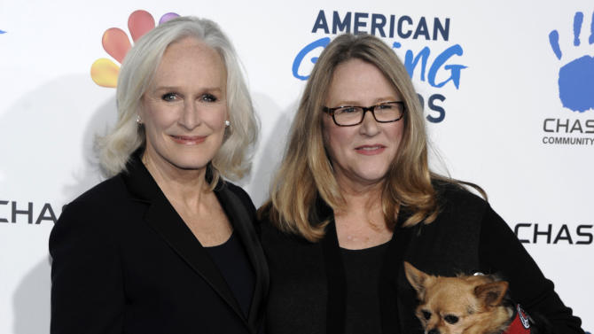 """FILE - This Dec. 7, 2012 file photo shows actress Glenn Close, left, and her sister Jessie Close at The American Giving Awards  in Pasadena, Calif. Grand Central Publishing announced Friday, April 26, 2013, that Jessie Close's """"Resilience"""" is scheduled for release in January 2015. The book will be co-written by Pete Earley, author of the 2006 book """"Crazy,"""" about his son's struggles. Glenn Close will contribute three """"vignettes"""" about her sister and an epilogue.  (Photo by Dan Steinberg/Invision/AP, file)"""