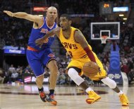 Cleveland Cavaliers&#39; Kyrie Irving (R) drives to the basket past New York Knicks defender Jason Kidd during the first quarter of their NBA basketball game in Cleveland March 4, 2013. REUTERS/Aaron Josefczyk