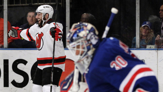 New Jersey Devils' Stephen Gionta, left, celebrates after scoring a goal past New York Rangers goalie Henrik Lundqvist, of Sweden, right, during the first period of Game 5 of an NHL hockey Stanley Cup Eastern Conference final playoff series, Wednesday, May 23, 2012, in New York. (AP Photo/Frank Franklin II)