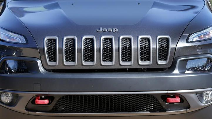 Front grill of a 2014 Chrysler Jeep Cherokee Trailhawk is seen on display outside Chrysler World Headquarters during the FCA Investors Day in Auburn Hills
