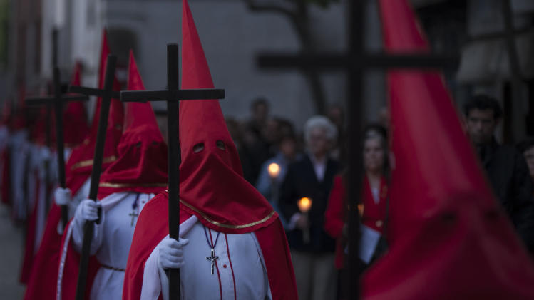 Penitents from 'Cristo de la Agonia' or 'Agony Christ' brotherhood take part in a Holy Week procession in Alcala de Henares, Madrid, Spain, Friday, April 18, 2014. Hundreds of processions take place throughout Spain during the Easter Holy Week. (AP Photo/Gabriel Pecot)