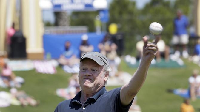 Tom Gage, The Detroit News' former traveling beat writer on the Detroit Tigers for 36 years, throws out a first pitch before the spring training exhibition baseball game between the Atlanta Braves and the Detroit Tigers in Lakeland, Fla., Monday, March 30, 2015. (AP Photo/Carlos Osorio)