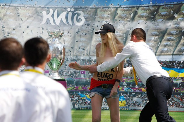Topless Ukrainian activists grab Euro 2012 cup