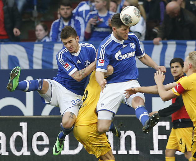Schalke's Klaas-Jan Huntelaar of the Netherlands, second from right, heads the ball during the German first division Bundesliga soccer match between Schalke 04 and 1899 Hoffenheim in Gelsenkirchen