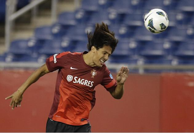 Midfielder Bruno Alves, of Portugal's national soccer team, heads a ball during practice in Foxborough, Mass., Monday, Sept. 9, 2013. Portugal will play team Brazil in a friendly match Tuesday in Foxb