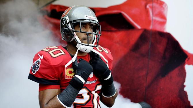 FILE - In this Dec. 23, 2012, file photo, Tampa Bay Buccaneers free safety Ronde Barber (20) waits in the tunnel before an NFL football game in Tampa, Fla. The Buccaneers announced Wednesday, May 8, 2013, that three-time All-Pro Ronde Barber is retiring after a 16-year career with the Buccaneers that included a Super Bowl title and five Pro Bowl appearances. (AP Photo/Brian Blanco, File)