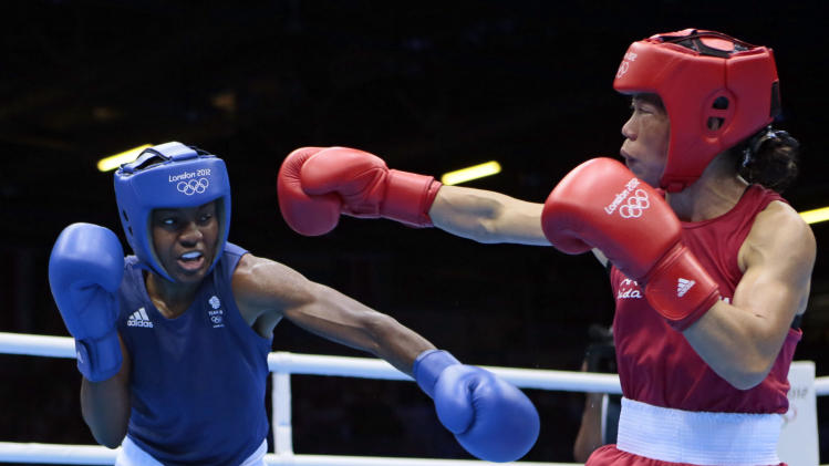 Great  Britain's Nicola Adams, left, and India's Chungneijang Mery Kom Hmangte fight during their women's flyweight 51-kg semifinal boxing match at the 2012 Summer Olympics, Wednesday, Aug. 8, 2012, in London.(AP Photo/Ivan Sekretarev)