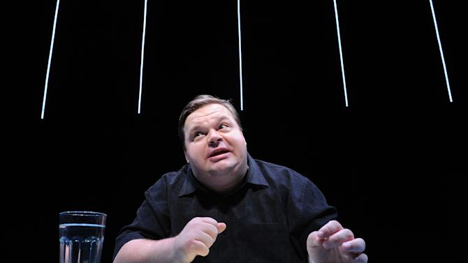 "In this undated image released by The Public Theater, Mike Daisey is shown in a scene from ""The Agony and The Ecstasy of Steve Jobs,"" in New York. Daisey, whose latest show has been being credited with sparking probes into how Apple's high-tech devices are made, is finding himself under fire for distorting the truth. The public radio show ""This American Life"" retracted a story Friday, March 16, 2012, that it broadcast in January about what Daisey said he saw while visiting a factory in China where iPads and iPhones are made. (AP Photo/The Public Theater, Stan Barouh)"