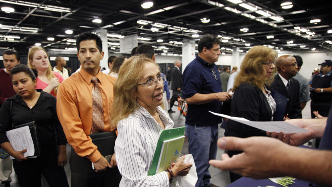 In this June 13, 2012 file photo, Maria Wilt, center, talks to a recruiter at a job fair expo in Anaheim, Calif.  A private survey released Thursday, July 5, 2012, shows U.S. businesses increased hiring in June, suggesting the job market could be recovering after three sluggish months. (AP Photo/Jae C. Hong, File)