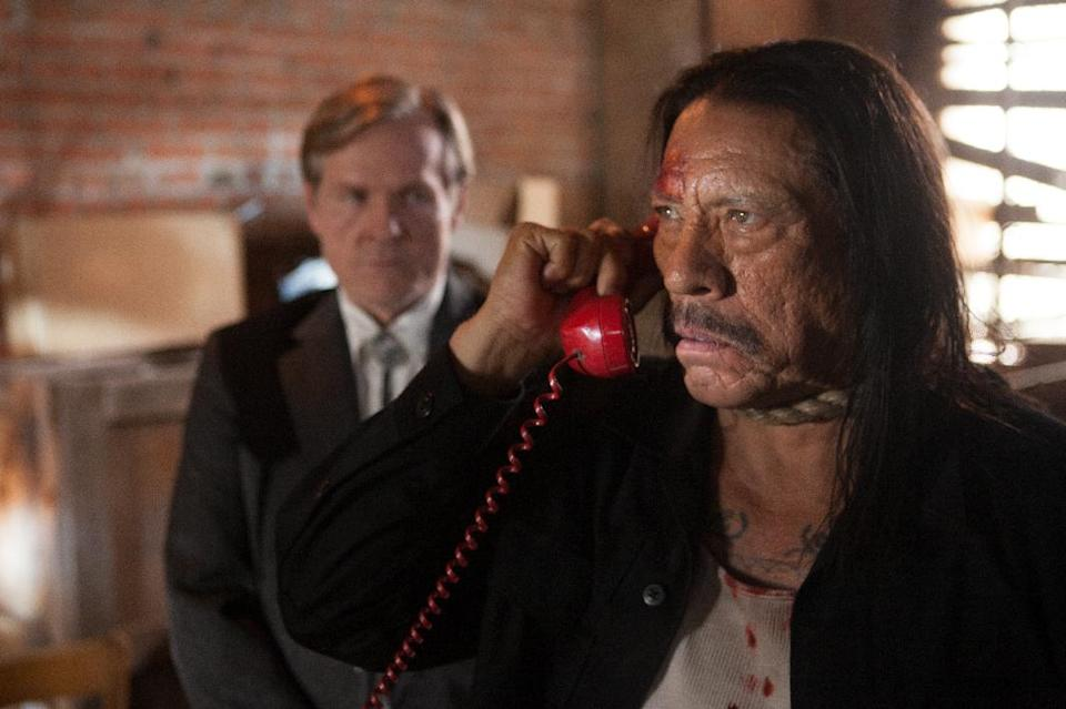 "This image released by Open Road Films shows Danny Trejo, right, in a scene from ""Machete Kills."" (AP Photo/Open Road Films, Rico Torres)"