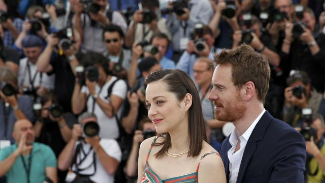 "Cast members Marion Cotillard and Michael Fassbender pose during a photocall for the film ""Macbeth"" in competition at the 68th Cannes Film Festival in Cannes"