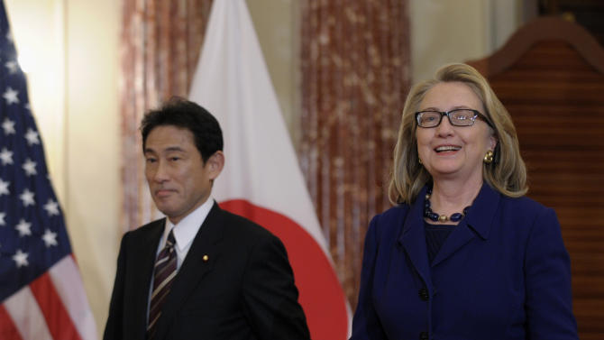 Secretary of State Hillary Rodham Clinton and Japanese Foreign Minister Fumio Kishida arrive for their joint press availability at the State Department in Washington, Friday, Jan. 18, 2013. (AP Photo/Susan Walsh)