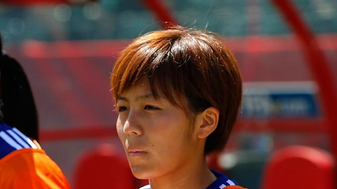 Mana Iwabuchi of Japan holds a bear wearing a shirt in honor of Kozue Ando, who broke her leg in an earlier match, prior to their FIFA Women's World Cup quarter-final match against Australia, at Commonwealth Stadium in Edmonton, on June 27, 2015
