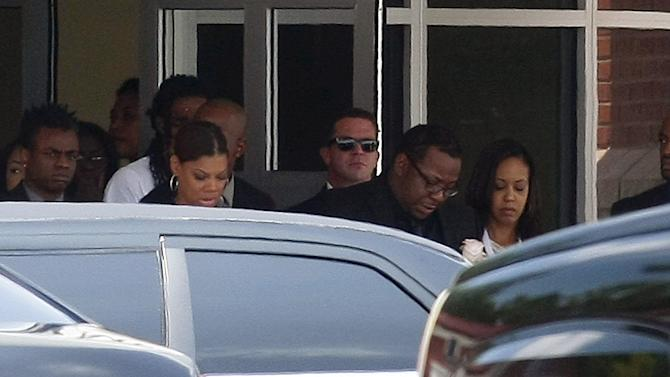 Brown leaves the funeral of daughter Brown, at Saint James United Methodist Church in Alpharetta
